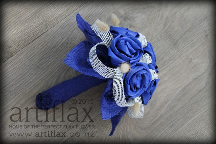 Cobalt blue and white flax flower bridal bouquet by Artiflax