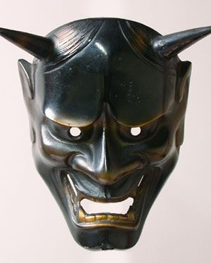 Hannya mask - The Noh drama, Japan - 8 inches, cast metal - The Hannya mask, with its horns and sharp fangs, is probably the best known of all Noh masks. This character was once a beautiful woman who fell in love with a priest. Her unrequited love causes her to turn into a monster who expresses the fury of a woman overwhelmed by jealousy and anger.
