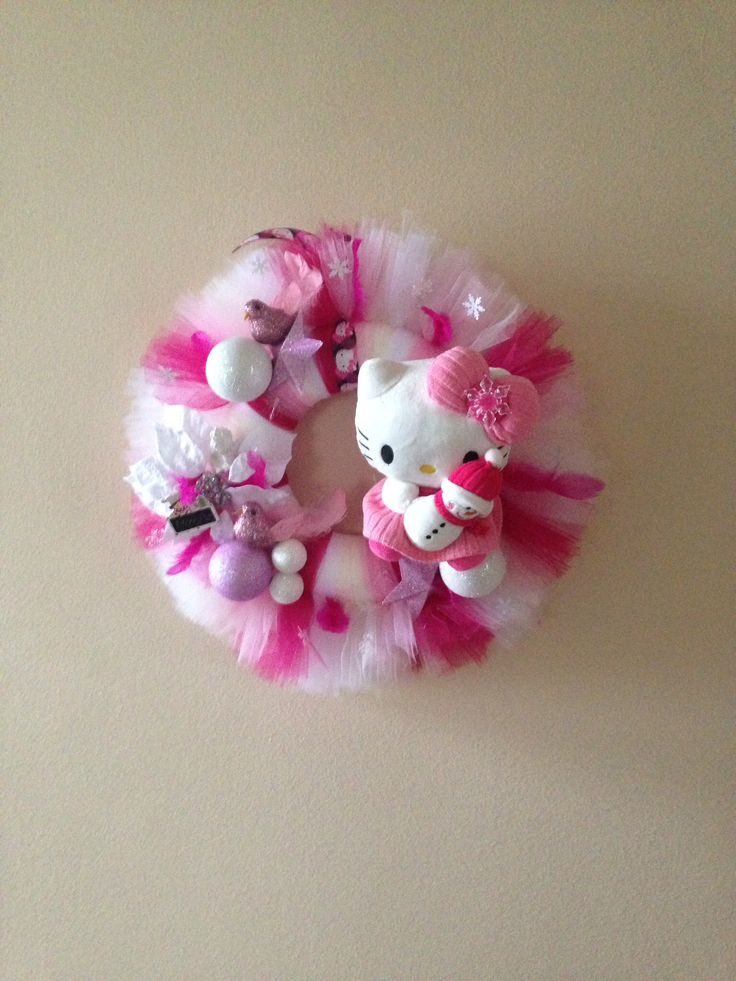 Christmas Hello Kitty wreath.  Added christmas ornaments, birds, snowflakes, white poinsettia flower head, wooden sign and a cute Hello Kitty plush doll.  More at https://www.facebook.com/Moje-vence-995508700482994/