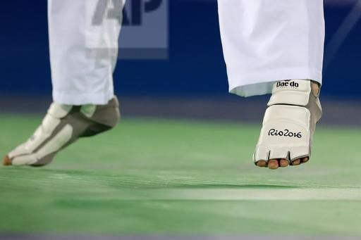 Oh Hyeri of South Korea moves as she competes against Farida Azizova of Azerbaijan during a 67 kg semifinal women's taekwondo contest at the 2016 Summer Olympics in Rio de Janeiro, Brazil, Friday, Aug. 19, 2016. (AP Photo/Gregory Bull)