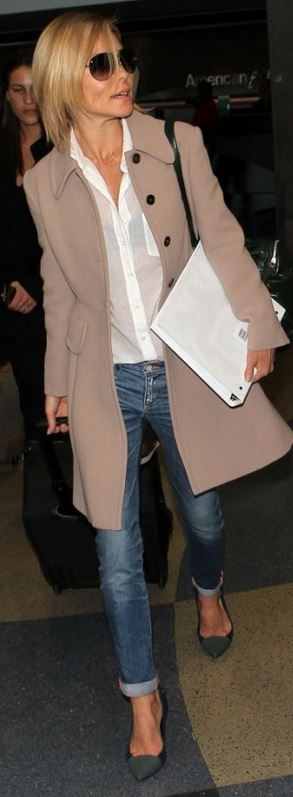 Cream button down blouse; Neutral wool swing coat; Skinny pegged jeans; Grey heels Accessories: Black bag; Black sunglasses