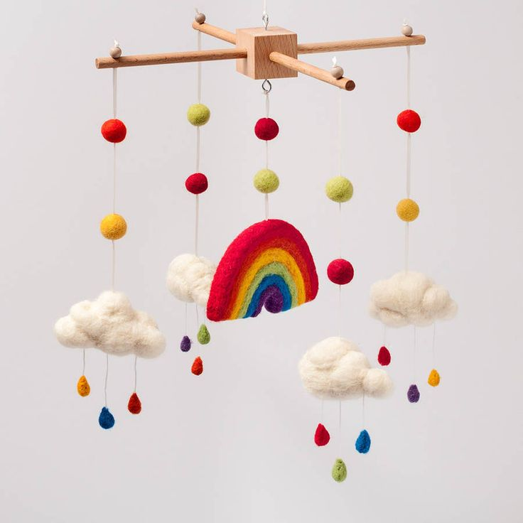 needle felt rainbow and clouds cot mobile by fox's felts | notonthehighstreet.com