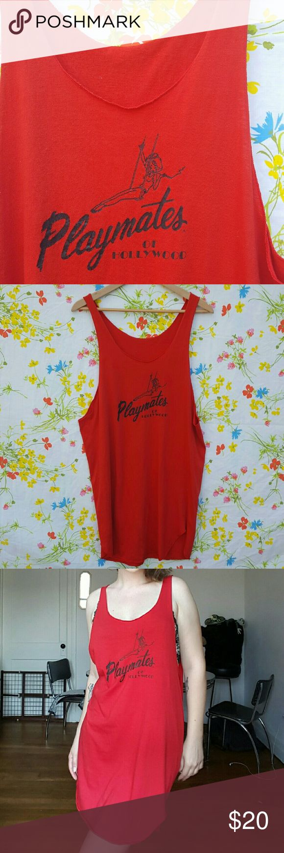 "Vintage Playmates of Hollywood Tank Dress Vintage Playmates of Hollywood Tank Dress! This is long enough to be a short dress or tunic with deep armholes. Marked a size L, 20"" armpit to armpit, 34"" long at longest point. The graphic is somewhat worn and there is light pilling throughout. Dresses Mini"
