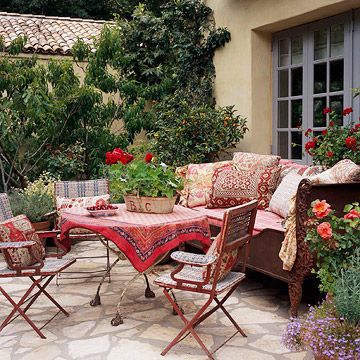 Bring the Indoors Out:   Revel in the views from your outdoor table. If you aren't lucky enough to look out on towering mountains or a body of water, craft a second-best scene by choosing a decorating theme, such as a Mediterranean-flavored table set with bright sari-inspired textiles.