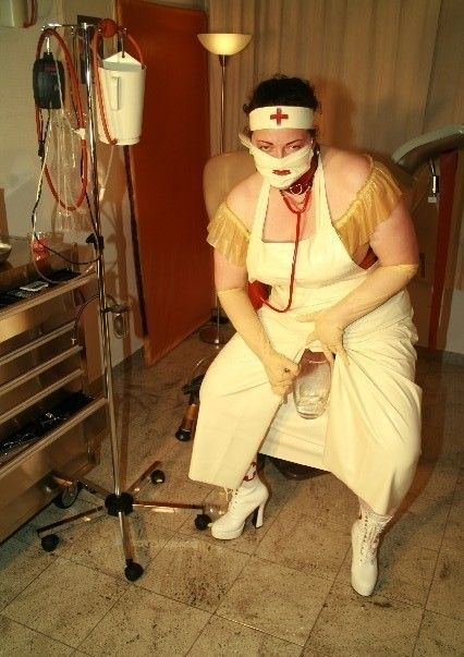 Rubber bondage corset orgasm
