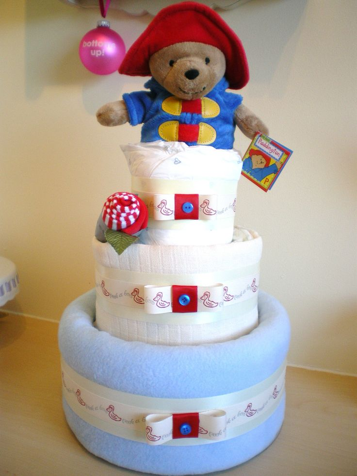 Blue 3 tier nappy cake with My First Paddington topper and sock rosebud.