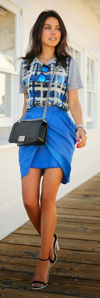 Gorgeous blue stylish skirts with top matching short sleeves and black leather hand bag and cute high heels sandals the best way to show fashion