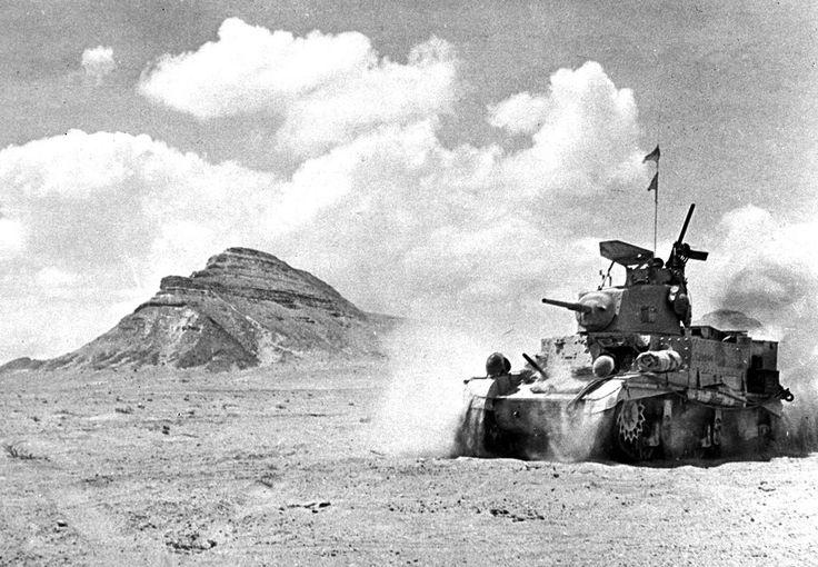 "A British unit in a U.S. built M3 Stuart ""Honey"" tank patrols at speed in Egypt's Western Desert near Mount Himeimat, Egypt, in September of 1942."
