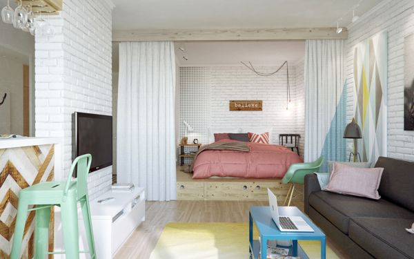 The sleep zone has been clearly segregated from the open plan layout by having its floor level raised up on a wooden platform that conceals ...