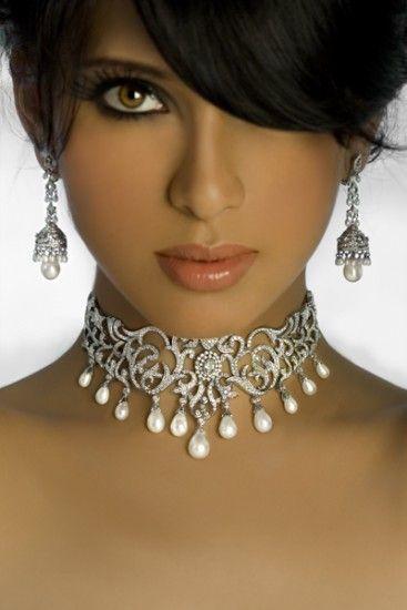 Sherri is wearing scrolled white gold. pearl and diamond jewelry...I <3