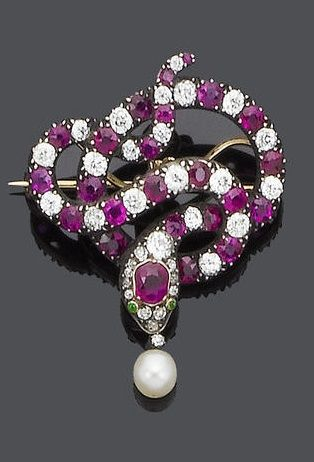 A 19th century ruby and diamond brooch/pendant, circa 1880. The coiled serpent set alternately with circular mixed-cut rubies and old brilliant-cut diamonds, to a cushion-shaped ruby crest and demantoid garnet eyes, the open mouth suspending a pearl and old brilliant-cut diamond drop, mounted in silver and gold, diamonds approx. 1.95ct. total., collapsible pendant fitting, removable brooch fitting. #antique #Victorian #brooch