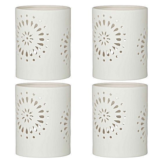 Let delicate light spark beauty in your home with the classic cut-out design of the Ella Hurricane Candle Holder, 14cm (Set of 4) from Emporium.