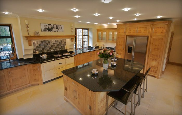 cream aga oven and timber cupboards