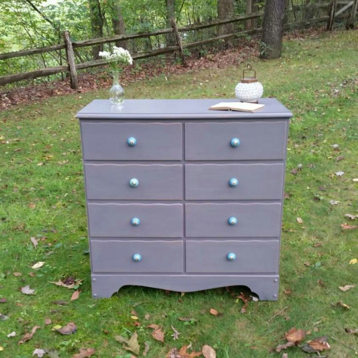 A sweet dresser in Driftwood Milk Paint and our Aqua Ceramic Knobs.
