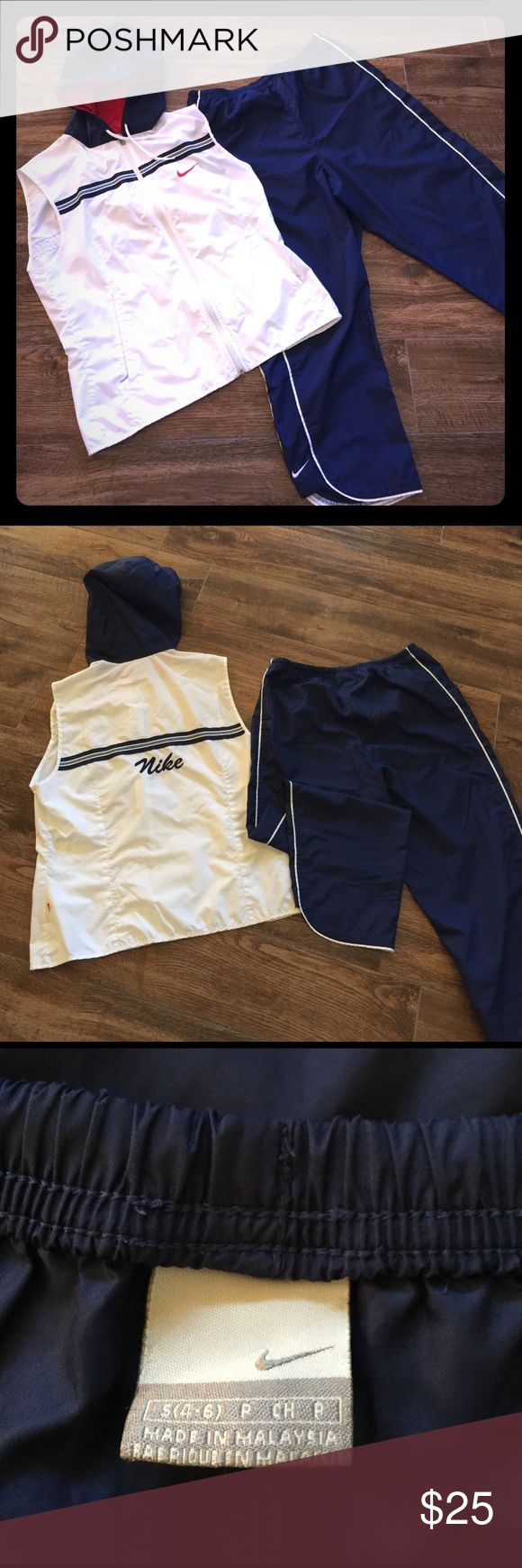 Nike Jogging Suit Lightweight material great for summer.  The matching set comes with a dark blue capri and white hooded vest.     The pants are a true 4/6. The vest runs small so I bought the bigger size (8/10) to go with the pants. Nike Other