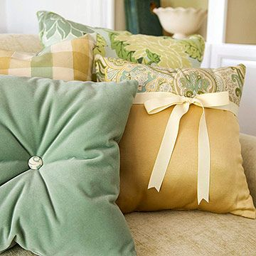 Pillows- sweet little additions bring whimsy to plain pillows:  tie a ribbon around a pillow just tight enough so no sewing is needed or select a pretty button for a puckered pillow (mark the button placement on the front and back exactly at center and use a long hand-sewing needle with upholstery thread to stitch it on)