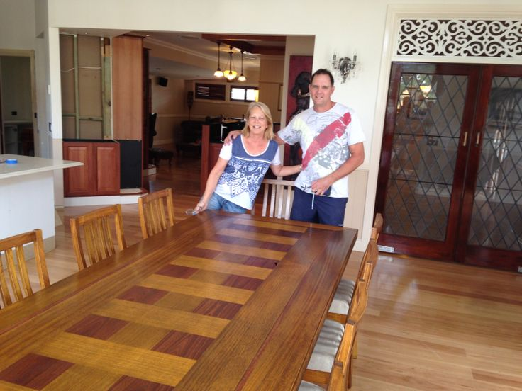 A happy couple with their new table.