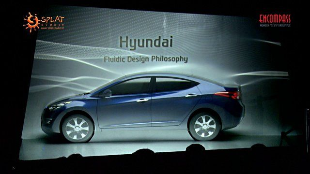 """At the 12th Autoexpo motor show 2014 in India, Hyundai Motors wanted people to experience their """"Fluidic Design Philosophy"""", the basis of all their vehicle designs. Each Hyundai car is designed with inspiration from the nature, and they needed to communicate this to the audience in the most effective way. Encompass events conceived the idea of Fluidic Theater, where Hyundai Elantra car became the canvas as well as the subject to visualize the fluidic philosophy. Splat Studio's creative…"""