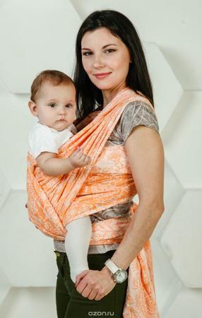 Мамарада Слинг-шарф Магические огурцы Soft Оранж размер 5,2  — 4739р.  Тканый слинг-шарф от ТМ «Мамарада» Жаккардовый, двусторонний Специально разработанная натуральная ткань для слингов. Ткань немного тянется по диагонали, что обеспечивает ее эластичность, и в тоже время не вызывает провисания ребенка. Слинг-шарф ТМ «Мамарада» прекрасно дышит, в жару впитывает влагу. Прочный, цепкий – позволяет носить даже тяжелого ребенка. Рисунок – магические огурцы, издревле применяемый для обережья, а…