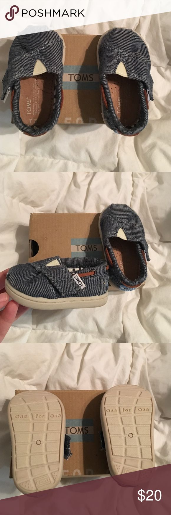 NWOT Baby toms NWOT tiny toms. Chambray material. I had bought for my daughter on Poshmark but they don't fit her 😬 the soles of the shoes look a little off in color in the pictures. I bought these brand new and only tried them on my daughter. In great condition. I'd like to get what I paid and not make anything off of them. TOMS Shoes Baby & Walker