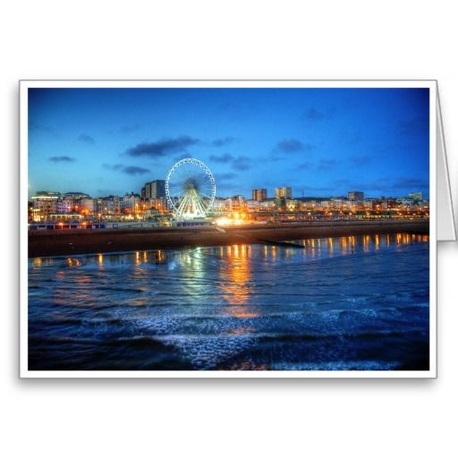 Illuminated Sands :- Here's a great shot of Brighton (South Coast of England) taken from it's famous pier. An unusually low tide revealed sand that we normally do not get to see causing the entire seafront to reflect and shimmer in the darkening evening sky. #wheel #ferriswheel #attraction #entertainment #seaside #coast #coastal #england #brighton #illumination #lights #sand #beach #sea #water #resort #fun #reflection #evening