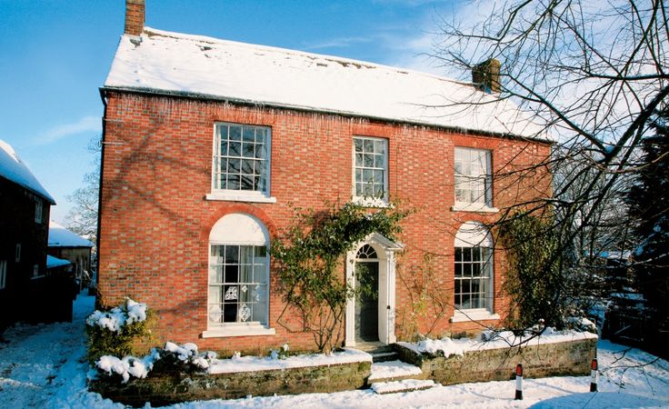 Red brick georgian double fronted farmhouse in the snow for Brick georgian homes