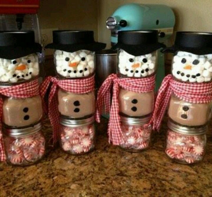 Snowman hot chocolate gifts: Three small jars, one filled with peppermints, one with hot chocolate mix, and one with marshmallows;