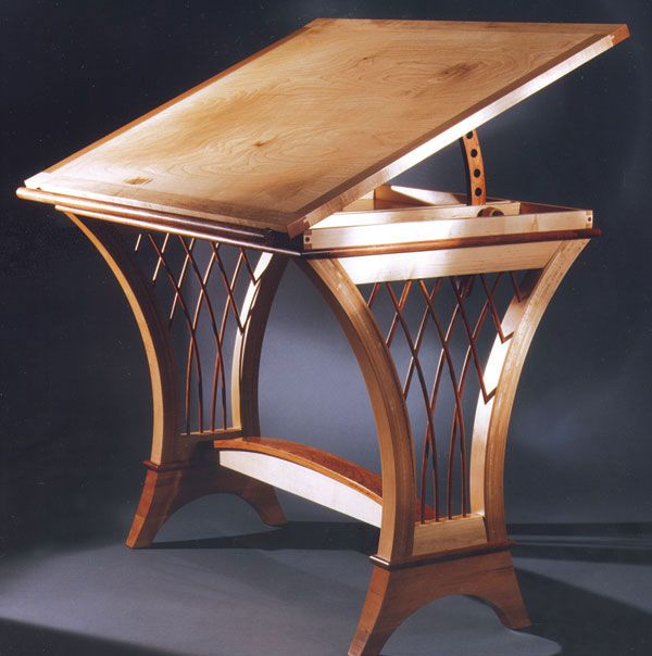 Mau wanted to design and build a drawing table for his wife, an illustrator, that would appear more feminine than the traditional drafting table. This drawing table is made from maple, cherry, and birch and is finished with tung oil and urethane.