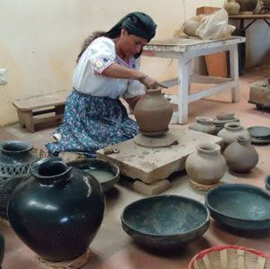 Oaxaca, Mexico Potter making the beautiful black pottery that you see only in Oaxaca