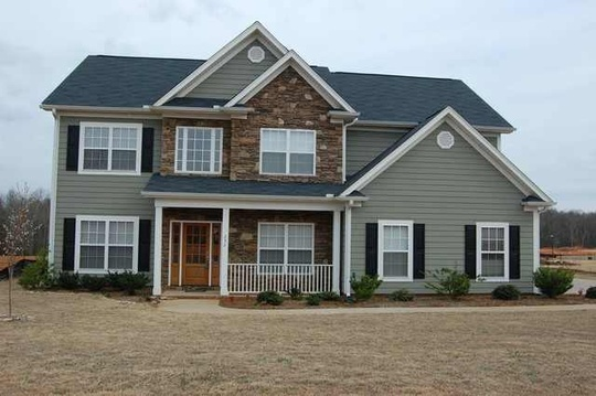 7 Popular Siding Materials To Consider: Stone And Hardie Board