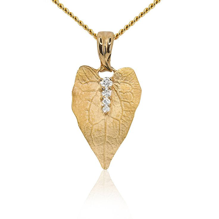 Be enchanted by the intricate design of the Fleur de Lis Leaf pendant. In 18ct white gold with diamonds. Length 23mm. Width 11mm. Chain included.