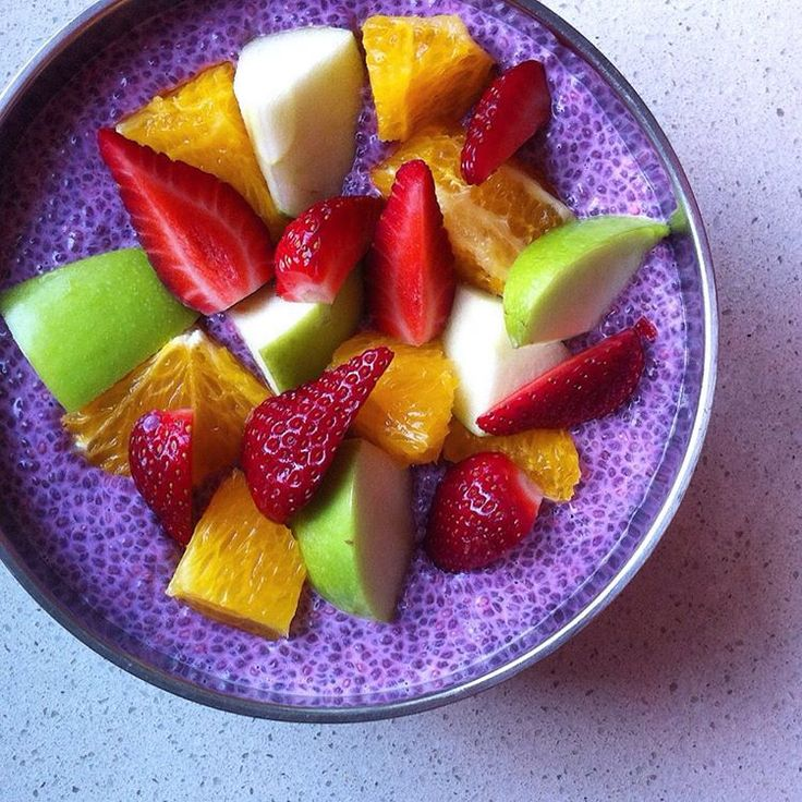 Beetroot chia pudding topped with orange, strawberries & apple.