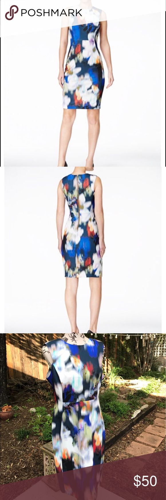 NWT Calvin Klein Dress NWT Calvin Klein Sheath Dress. Body smoothing scuba material. Ultramarine Multi coloured.  Calvin Klein Blurred floral print sleeveless sheath dress features a round neck and zipper closure. Measures 38 inches shoulder to hem. 95% Polyester, 5% Spandex. Dry clean. Size 12 Calvin Klein Dresses