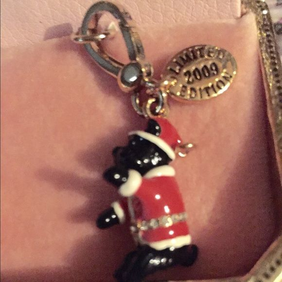 Juicy Couture Charm LTD 2009 Juicy Couture Yorkie Wearing a Santa Suit Charm. Super cute with crystals around the suit. Not for sale, just sharing from my personal collection. Thanks for looking! Juicy Couture Jewelry