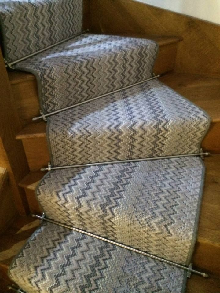 A Beautiful Accent To This Zig Zag Stair Look Br Flooring | Zig Zag Stair Carpet | Winding Staircase | Geometric | Metal Bar On Stair | Red | Traditional