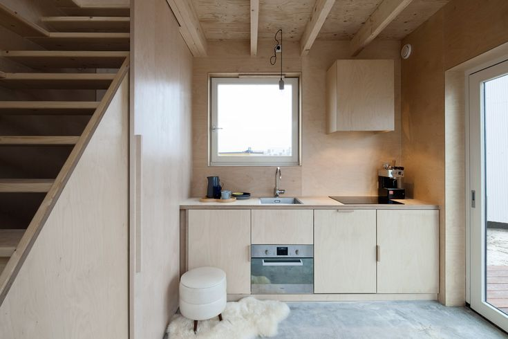 Sliding doors and built-in furniture save space inside skinny house