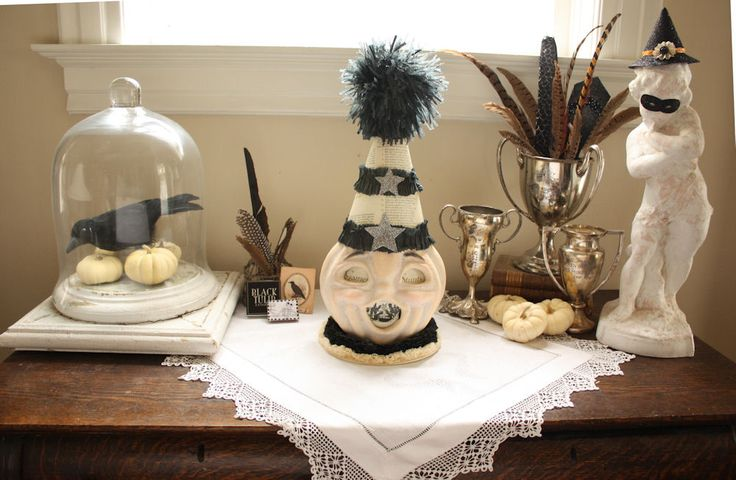 love this halloween decor especially the mask and hat on the statue! || French LaundryVintage Halloween, Fall Decor, Laundry White, Black And White, White Pumpkin, White Wednesday, French Laundry, Halloween Ideas, Wednesday Pumpkin