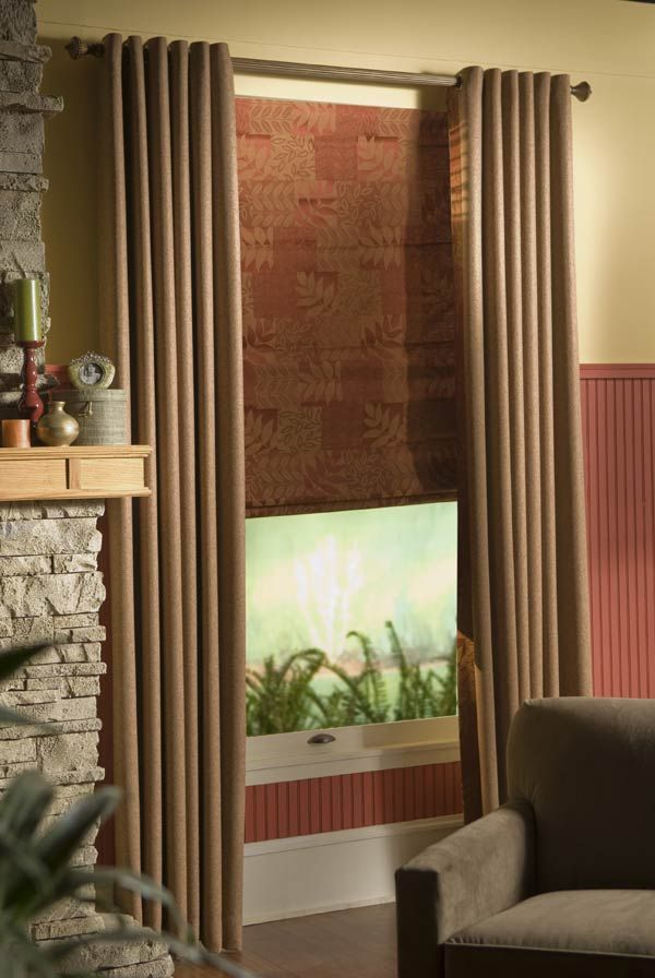 Grommet Draperies with custom roman shade comes