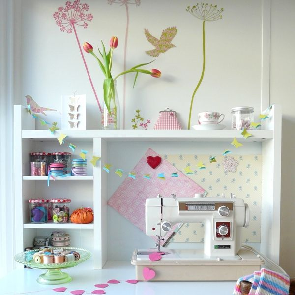 so sweet  like the painted flowers and the small shelves around the sewing machine.