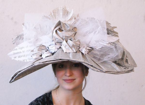 The Modern Woman Wears Knowledge by Alicia Kovalcheck, via Behance.  This is a wearable sculpture made out of newspaper pages and book pages that replicates the style of Victorian era women's hats to reference the Women's Suffrage Movement and the changing societal standards.