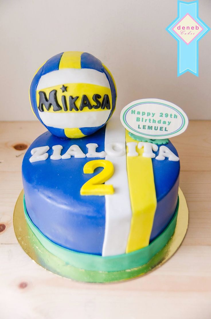 For a voleyball player - the jersey cake with volley ball.