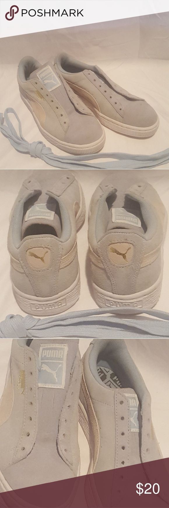 Light blue Puma's A couple stains on the toe area as shown in the picture. Other than that in great condition. Shoes Sneakers