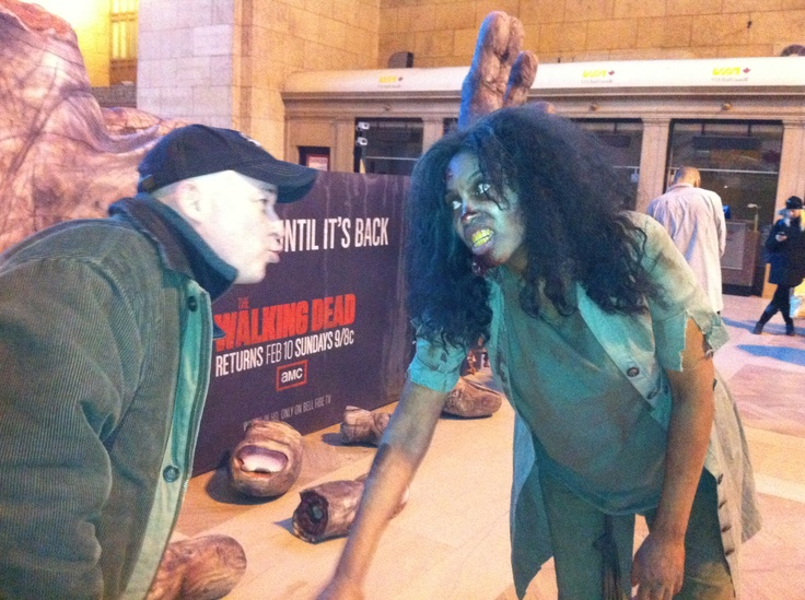 AMC's The Walking Dead has a fun promo going on this week at Toronto's Union Station, complete with chained up Zombies and two giant zombie hands (a finger falls off each day we get closer to the start of the new WD season on Sunday). Here's me tempting fate.