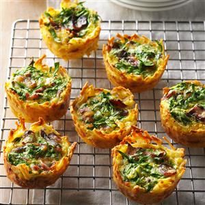 Hash Brown Quiche Cups Recipe -Quiche cups are my showstopper potluck dish. Hash browns and Asiago cheese make up the crusts. Eggs, spinach and bacon do the rest. —Nicole Stone, Gilbertville, Iowa