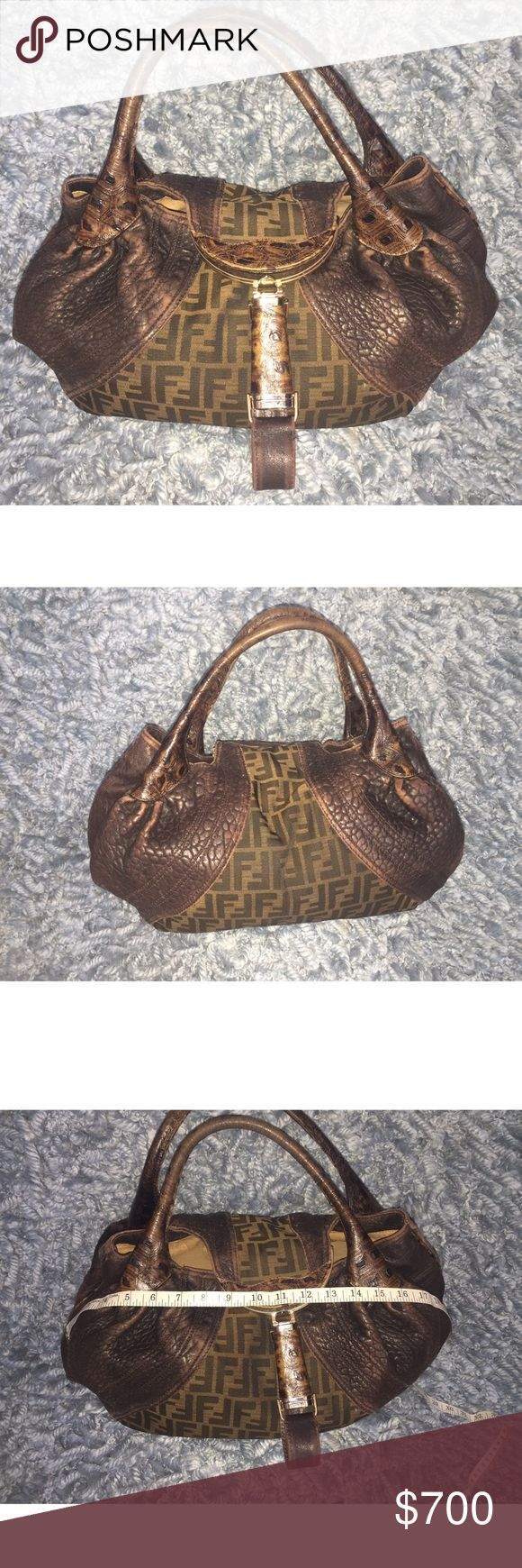 "Fendi Spy Bag Fendi Spy bag.  In excellent condition.  Comes with Dust bag.  Measurements: Handle Drop 6"", Height 10"", Width 13"", Depth 5"".  Because of the shape, the measurements may not be true to what i have found.  It can stretch out to 17"", as shown on photo. Fendi Bags Totes"