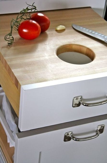 i really like this idea for the kitchen trash.. :)