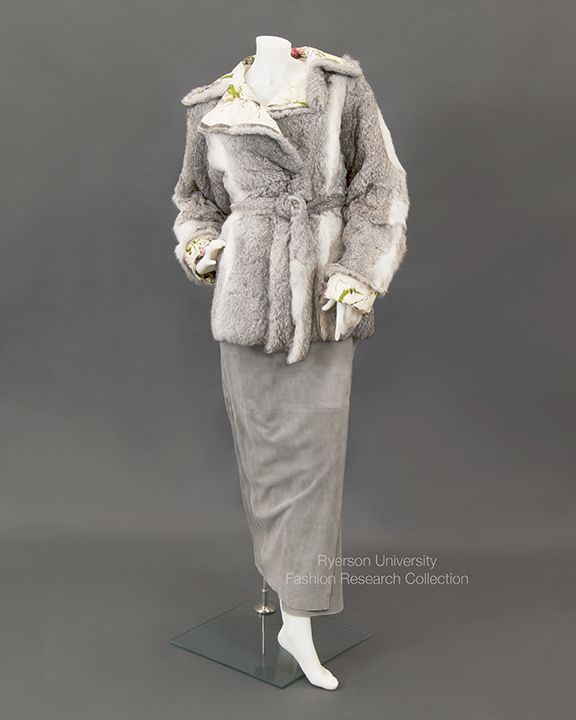 Gray suede long wrap skirt and matching fur and floral painted leather jacket with tie belt. By Dolce and Gabbana. C. 1990-2000. FRC 2009.01.227/FRC 2009.01.226 A+B