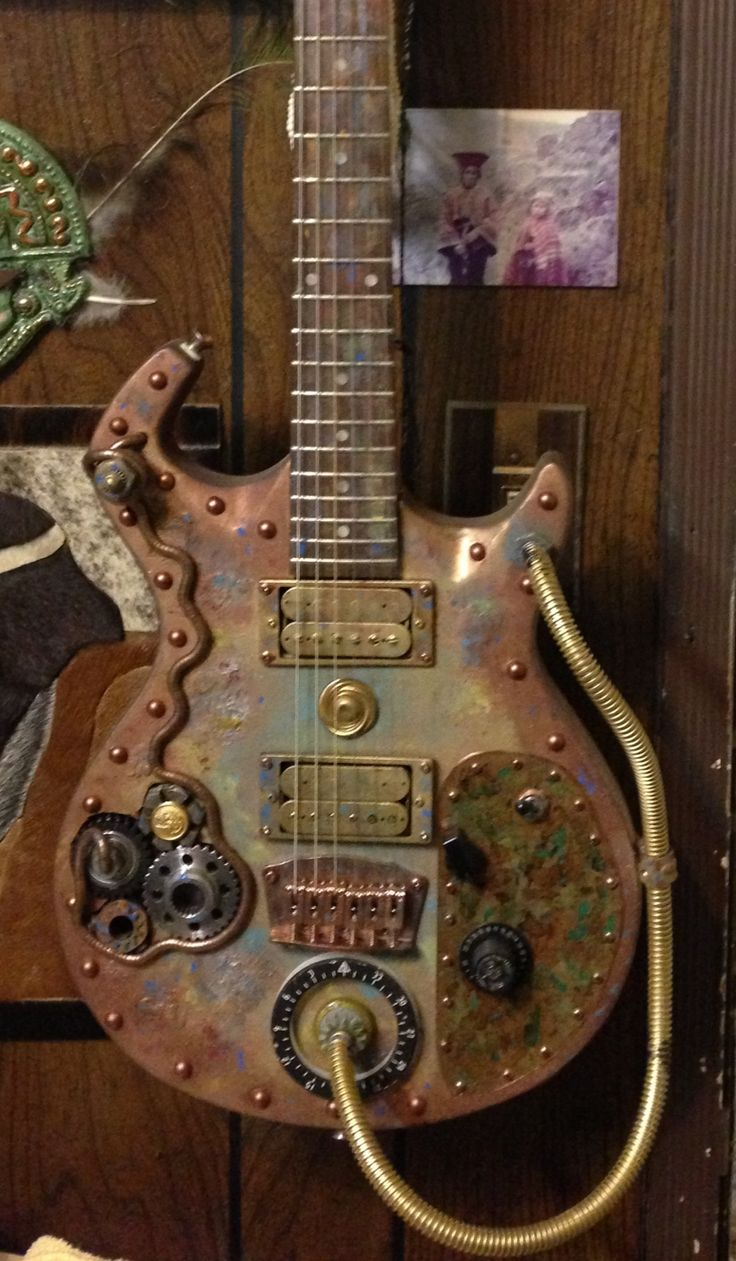 Rock & bowled over!  Steampunk guitar by Chuck Jonkey