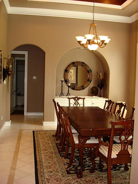 A Closer View Of The Dining Room Shows Arched Doorways Windows And Recessed
