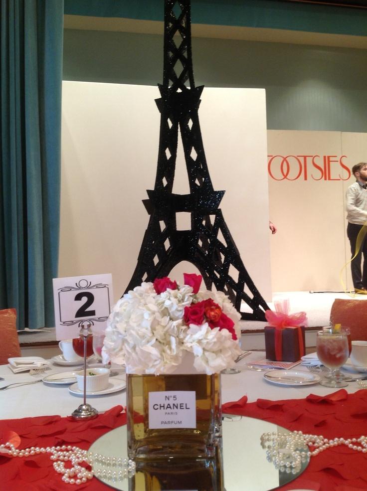 Springtime in Paris theme for NCL fashion show with faux Chanel No. 5 centerpieces by Fleur de Vie.
